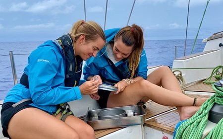 Image of Kristine Berg and Laura Wells examine samples