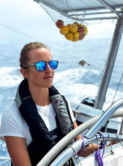 Image of Kristine taking the helm