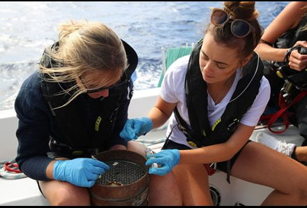 Image of crew collecting microplastic sample