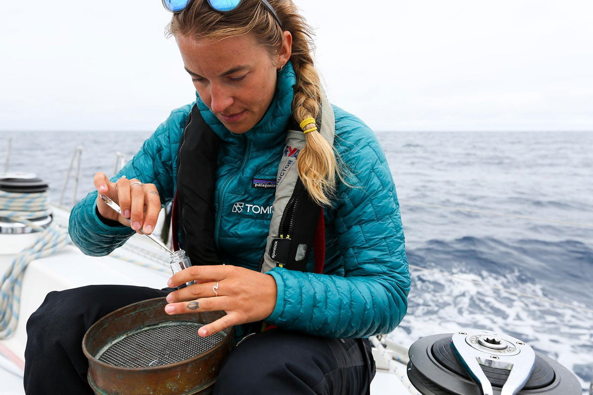 Image of Kristine collecting microplastics ample